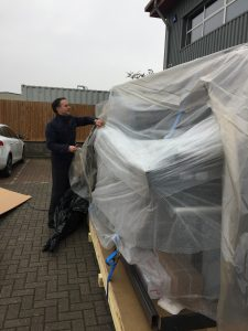 Abbey Labels Chairman Unwrapping a New Machine