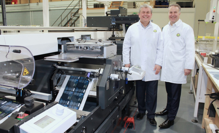 Barry Pettit and Tom Allum from Abbey Labels stand with new die cutting machine